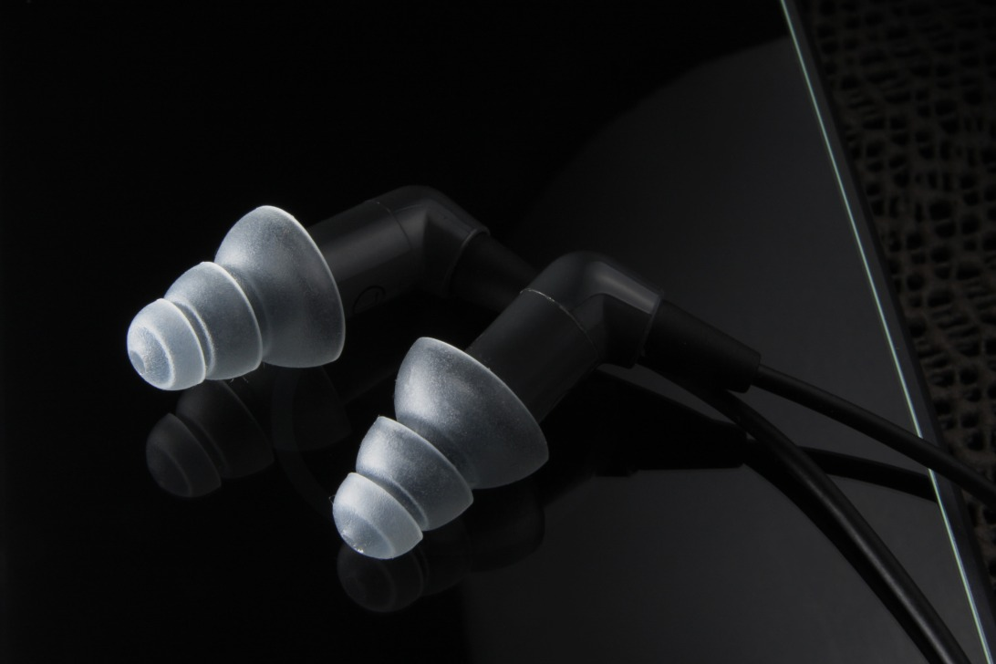 The Etymotic MK5 Isolator, pictured with the ER38-15SM frosted grey triple flange silicone tips.